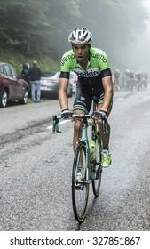 COL DU PLATZERWASEL,FRANCE - JUL 14: The cyclist Maarten Wynants of  Belkin Pro Cycling Team, climbing the mountain pass Platzerwasel in Vosges Mountains during Le Tour de France on July 14 2014