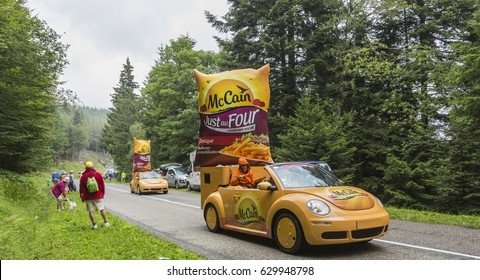 COL DU PLATZERWASEL,FRANCE - JUL 14: McCain vehicles during the passing of the advertising caravan on the road to route to the mountain pass Platzerwasel during Le Tour de France on July 14 2014