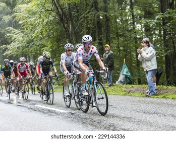 COL DU PLATZERWASEL,FRANCE - JUL 14:The German cyclist Tony Martin wearing Polka Dot Jersey climbing the road to mountain pass Platzerwasel, Vosges Mountains,during Le Tour de France on July 14 2014