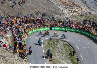 Col du Tourmalet, France - July 20, 2019: The group of the leaders of the General Classification, riding in a hairpin curve on the road to Col du Tourmalet during the stage 14 of Tour de France 2019.