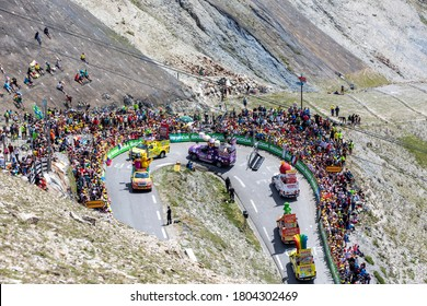 Col du Tourmalet, France - July 20, 2019: The Haribo Caravan during the passing of The Pubilicity Caravan before the cyclists on the road to Col du Tourmalet during the stage 14 of Tour de France 2019