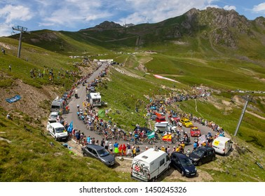 Col du Turmalet, France - July 27, 2018: The peloton, including Geraint Thomas in Yellow Jersey, is climbing the road to Col du Tourmalet in Pyrenees during the 19 stage of Tour de France 2018.