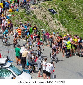 Col du Turmalet, France - July 27, 2018: The breakaway with Julian Alaphilippe in Polka-Dot-Jersey, climbing the road to Col du Tourmalet in Pyrenees during the 19 stage of Tour de France 2018.