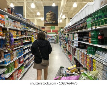 Cola and chip aisles inside local Publix grocery store Saint Augustine, Florida USA. February 19, 2018