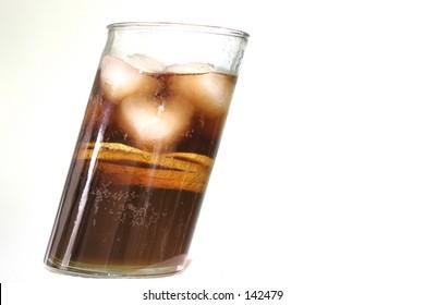Cola - in a diagonal glass, macro, shallow DOF.