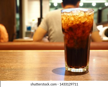 Cola drink and ice in the glass. Drink that have a good taste, Unhealthly diet with sweet sugary soft drinks concept.