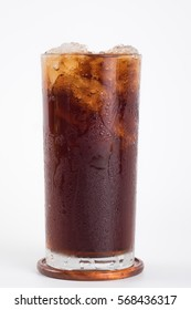 Cola in glass on coaster with ice isolated on white background