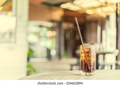 Cola glass in restaurant - vintage effect style pictures