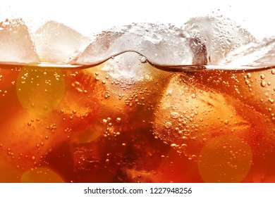 Cola With Ice Cubes In Glass Close-up