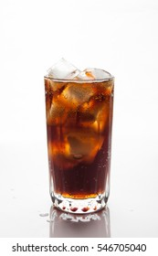 Cola with ice in a glass on white background