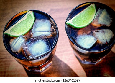Cola with ice and lime is a cool soft drink. Summer time. Rum with cola. Alcoholic Cocktai