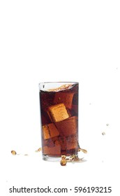 Cola with ice splashing out of a glass., Isolated white background.