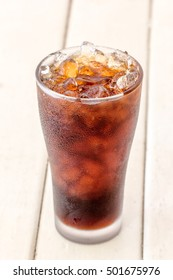 Cola soda in glass with ice