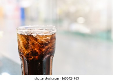 Cola soft drink with Ice ,Cola Glass close-up on abstract blurred restaurang backgrounds
