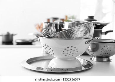 Colanders and tray on kitchen table
