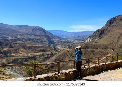 Colca Canyon, Peru - A photographer at the edge of the Colca Canyon