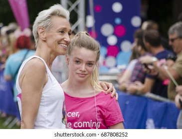 Colchester, Essex, England, UK- 16 July 2017-  a mother with her daughter happy at the end of the annual race for life event, helping to raise money for cancer research UK.