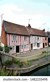 COLCHESTER, ESSEX, UK - AUGUST 4, 2019. Distorted medieval cottages overlook the River Colne in the town of Colchester in the English county of Essex, UK.
