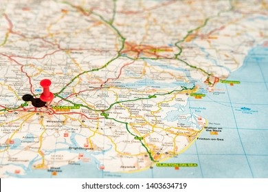 Colchester, Essex, UK - Circa May 2019: Shallow focus of the capital city of Essex, UK. The city is located by a red push-pin, seen with a large road network in the East Anglian area.