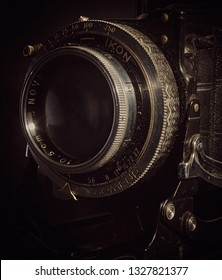 Colchester, Essex, UK – March 3: Extreme close up of the lens on a vintage bellows 120mm film camera.