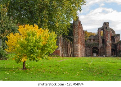 Colchester Essex UK park in autumn. St Botolphs Priory ruins.