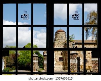 COLCHESTER ESSEX/UK APRIL 19 2017 Colchester Castle seen through the panes of a café window.