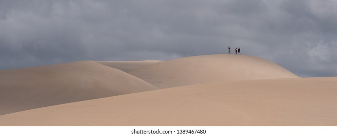 Colchester, South Africa. March 2019. People at the top of the sand dunes, at the Alexandria coastal dune fields near Addo / Colchester on the Sunshine Coast in South Africa.