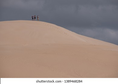 Colchester, South Africa. March 2019. Tourists at the top of the sand dunes, at the Alexandria coastal dune fields near Addo / Colchester on the Sunshine Coast in South Africa.