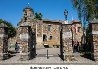 COLCHESTER, UK - MAY 7TH 2018: A view of Colchester Castle through one of the entrances into Colchester Castle Park, in the hostoric market town of Colchester in Essex, UK, on 7th May 2018.