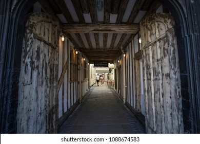 COLCHESTER, UK - MAY 7TH 2018: The timber-framed entrance to the historic Red Lion Hotel in the market town of Colchester in Essex, on 7th May 2018. The hotel is said to be haunted.