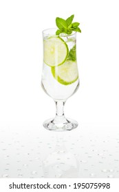 Cold alcoholic cocktail. Glass with drink stands on the surface covered with water drops