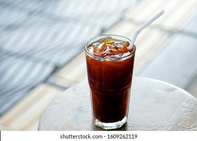 cold americano coffee in a tall glass, ice black coffee refreshing