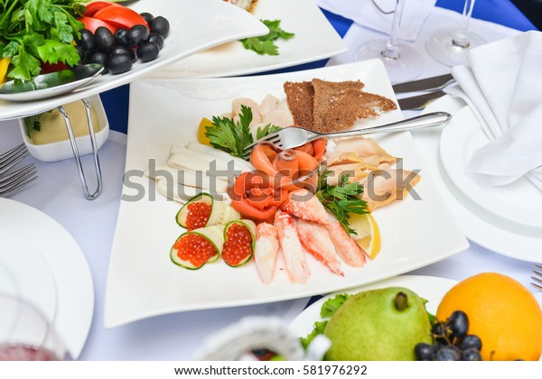 cold appetizer with seafood. salmon caviar, shrimp