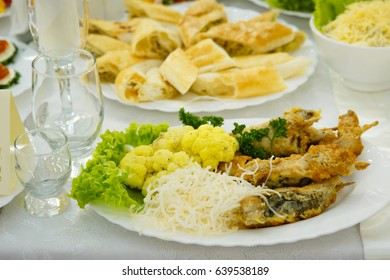 cold appetizers vegetables meats and seafood in the restaurant menu,table decoration for guests with exquisite dishes of national cuisine
