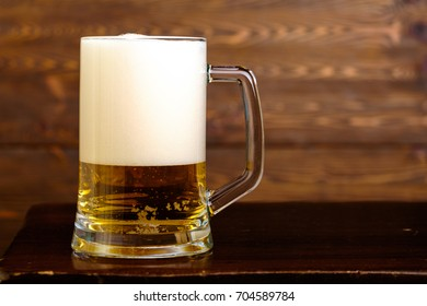 Cold beer with high foam.