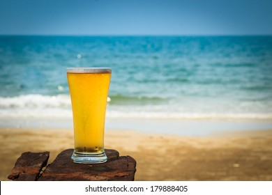 Cold beer on wooden  in front the sea of Thailand