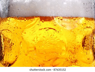 cold beer with suds in glass