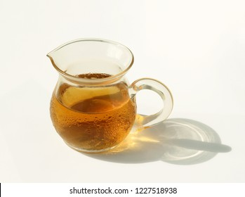 Cold black tea with glass tea pot, tiny drops of moisture have formed, beads of sweat, water drops