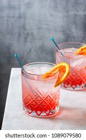 Cold Blood Orange Gin and Tonic Cocktails in Glasses on Marble Bar Top with Copy Space