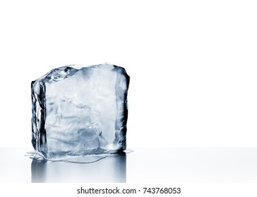 Cold blue crystal clear frozen block of ice melting to create pool of water on scratched steel surface