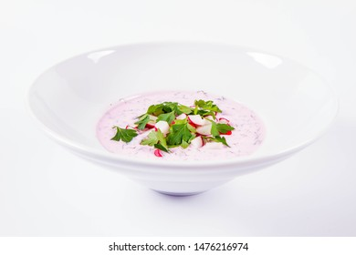 Cold borscht (chlodnik) - traditional Lithuanian cold soup with radish, parsley and dill