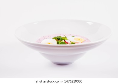 Cold borscht (chlodnik) - traditional Lithuanian cold soup with radish, parsley, dill and egg