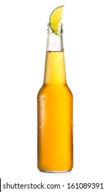 cold bottle of beer with lime on white background