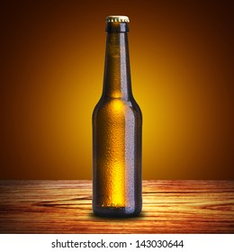 Cold Bottle of Beer on wood table