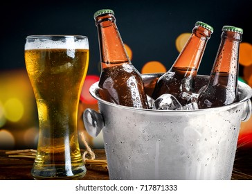 cold bottles of beer in bucket with ice in a restaurant setting