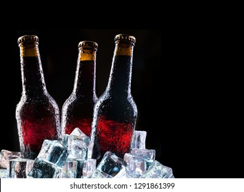 Cold bottles and fresh beer with ice