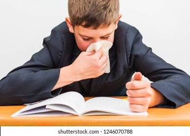 cold boy wipes his nose with a napkin