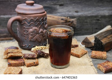 Cold bread kvass on a wooden background