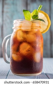 Cold brew coffee or black tea in a mason jar