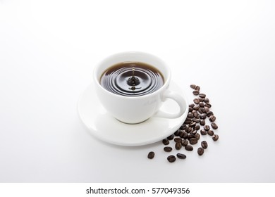 cold brew coffee cup and coffee beans on white background